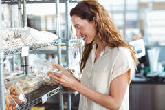 Pretty woman shopping in the bakery Royalty Free Stock Image