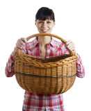Pretty woman and wicker basket Royalty Free Stock Images