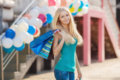 Pretty woman shopping at the mall on a sunny day Stock Photo