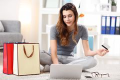 Pretty woman shopping online with credit card. Picture showing pretty woman shopping online with credit card Royalty Free Stock Photos