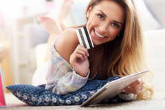 Pretty woman shopping online with credit card. Picture showing pretty woman shopping online with credit card Stock Photos