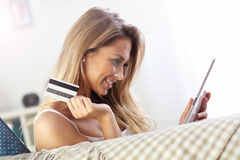 Pretty woman shopping online with credit card Royalty Free Stock Photo