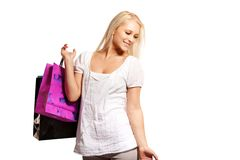 Pretty Woman on a Shopping Spree. Looking happy with her purchases stock image
