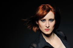 Pretty woman with short fashion bob hairstyle. Beauty portrait of pretty woman with short fashion bob hairstyle. black background Royalty Free Stock Photos