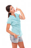 Pretty woman in short jeans gesturing phone call Royalty Free Stock Photography