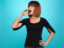 Pretty woman shouting with hand at mouth Royalty Free Stock Photos