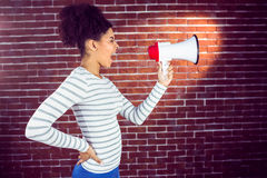 Pretty woman shouting with megaphone Stock Photo