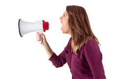 Pretty woman shouting with megaphone Stock Image