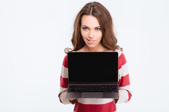 Pretty woman showing blank laptop compter screen Stock Photo
