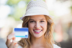 Pretty woman showing a credit card Royalty Free Stock Image