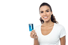 Pretty woman showing credit card to camera Royalty Free Stock Photo