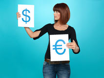 Pretty woman showing dollar and euro signs Royalty Free Stock Photos