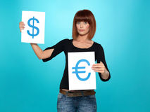 Pretty woman showing dollar and euro signs Royalty Free Stock Photography