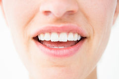 Pretty woman showing her teeth Royalty Free Stock Photos