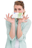 Pretty woman showing an one hundred euro note Royalty Free Stock Image