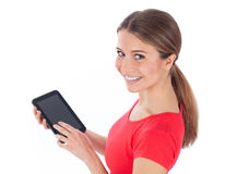 Pretty woman showing tablet pc Stock Photo