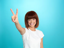 Pretty woman showing victory sign Royalty Free Stock Photography