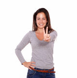 Pretty woman showing victory sign with her fingers Stock Photo