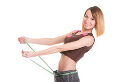 Pretty woman shows her weight loss wearing measure tapes isolate Royalty Free Stock Photo