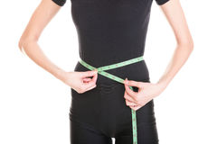 Pretty woman shows her weight loss wearing measure tapes isolate. D on white stock images