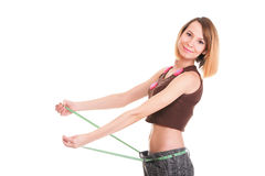 Pretty woman shows her weight loss wearing measure tapes isolate. D on white stock photos