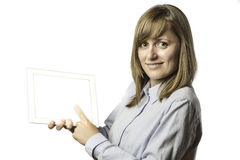 Pretty woman shows something on tablet computer Stock Photography