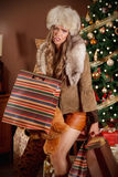 Pretty woman sick of shopping. Beautiful woman sick and tired of Christmas shopping Stock Photography