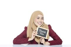 Pretty woman with a sign in her hands with the words THANK YOU i. Solated on white background Royalty Free Stock Photography