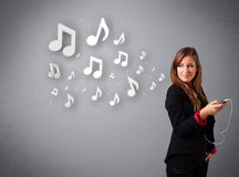 Pretty woman singing and listening to music Stock Image
