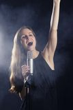 Pretty Woman Sings Concert Royalty Free Stock Photos