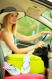 Pretty woman sit in car with suitcase. Summer road trip, travel concept. Pretty woman sit in car with suitcase, ready for the journey on holidays Stock Photos