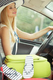Pretty woman sit in car with suitcase. Summer road trip, travel concept. Pretty woman sit in car with suitcase, ready for the journey on holidays Royalty Free Stock Photography