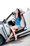 Pretty woman sits in the cabriolet with door opened Stock Image