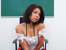 Pretty woman sits in classroom Royalty Free Stock Photography