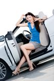 Pretty woman sits in the white car with door opened Royalty Free Stock Image