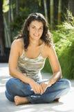 Pretty woman sitting. Stock Image