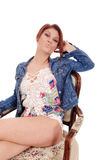 Pretty woman sitting in armchair. Royalty Free Stock Images