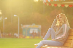 Pretty woman in sitting on the bench in city park Royalty Free Stock Images