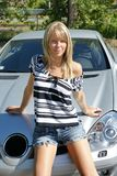 Pretty woman sitting on car Royalty Free Stock Photo