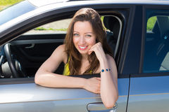 Pretty woman sitting in the car. Stock Image