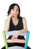 Pretty woman sitting on a colorful chair Royalty Free Stock Photography