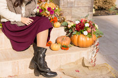 Pretty woman sitting on a decorated porch royalty free stock photography