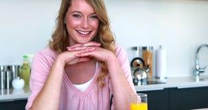 Pretty woman sitting having healthy breakfast stock video