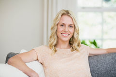 Pretty woman sitting on her couch Royalty Free Stock Photo
