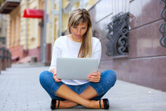 Pretty woman sitting with laptop Royalty Free Stock Image