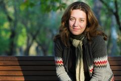 Pretty Woman Sitting On A Bench In Park Royalty Free Stock Photo
