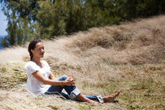 Pretty Woman sitting peacfully in nature Royalty Free Stock Photo