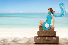 Pretty woman sitting on retro suitcases Royalty Free Stock Image