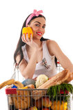 Pretty woman sitting in a supermarket trolley. With pepper Royalty Free Stock Photo