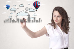 Pretty woman sketching cityscape with colorful balloons Stock Photography